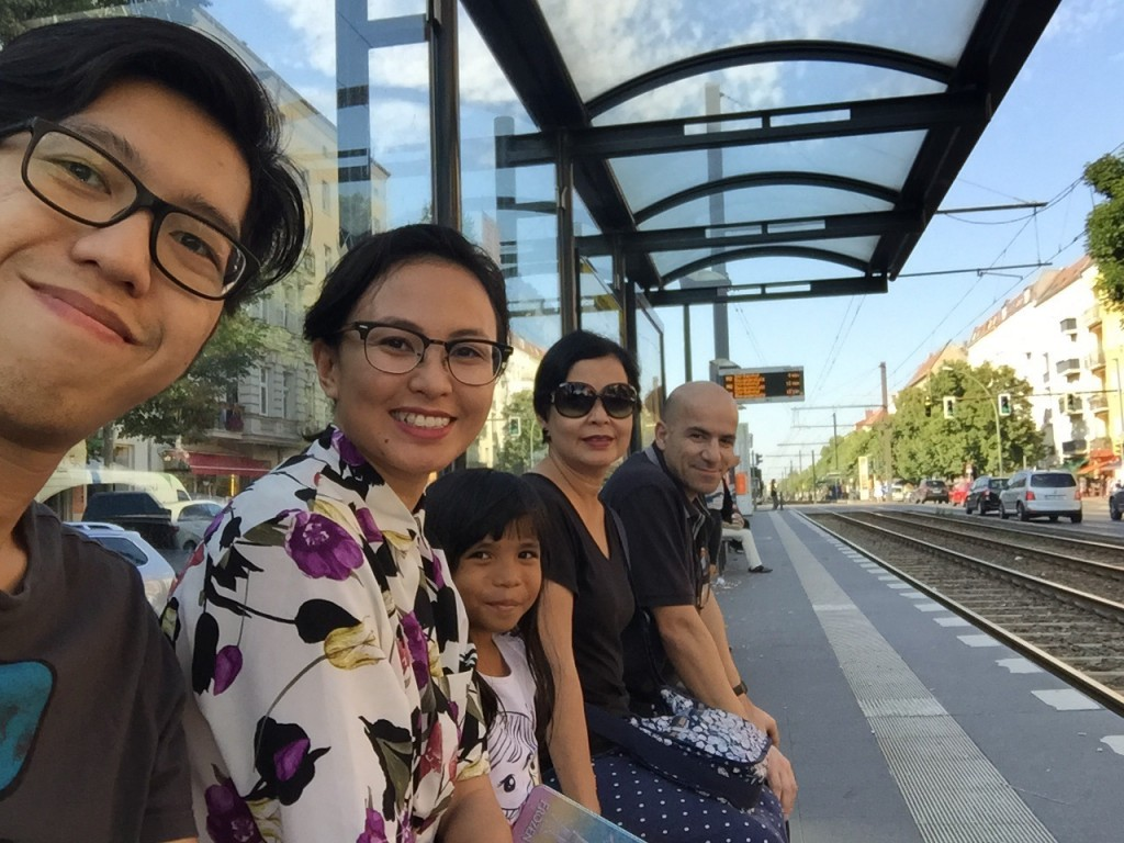 Asians and an Algerian waiting for the tram. #fam